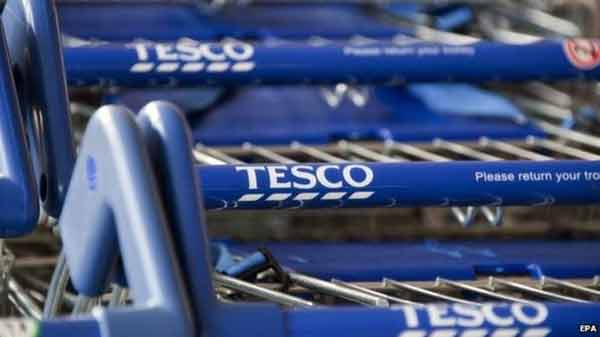 Tesco posts record £6.4bn annual loss