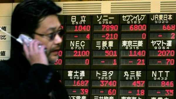 Asian shares close mixed as Trump's Asia tour gets rolling