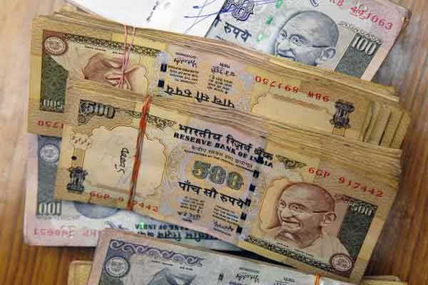 Rupee up 5 paise at 64.01