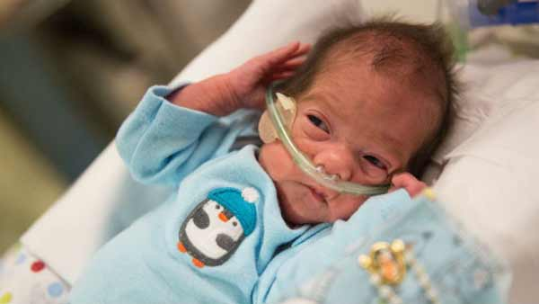 Brain-dead woman kept alive 54 days delivers boy