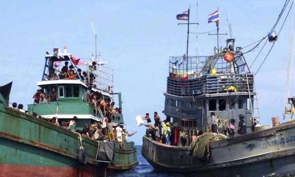 Myanmar escorting migrant boat to Bangladesh