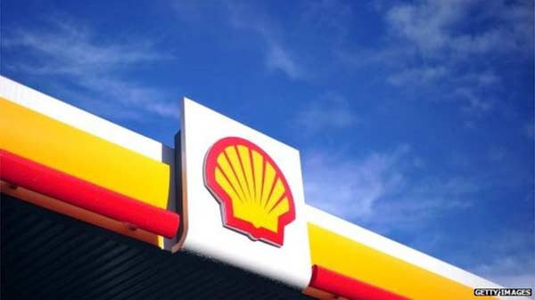 Shell shares rise as profits fall