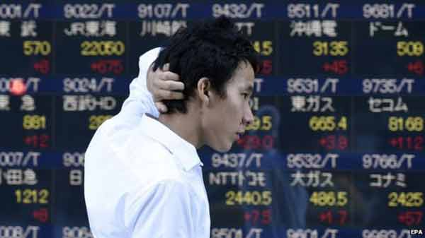Asia stocks down as yuan again lower