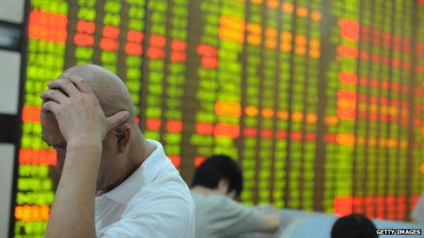 China shares slide in volatile trade