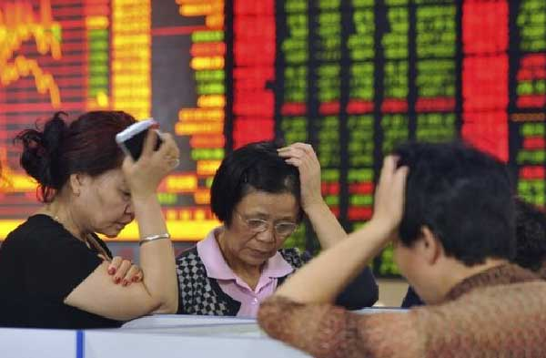 Chinese shares fall on disappointing manufacturing data