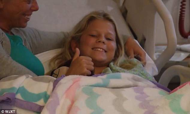 10-yr-old girl bitten by Shark goes back in water to save friend
