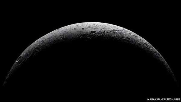 'Farewell' pictures of Saturn moon Dione