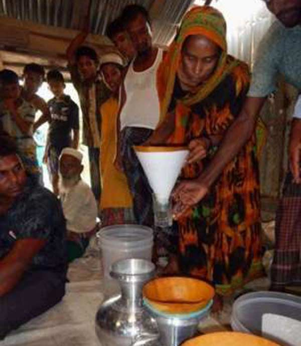 Bug-killing book pages clean murky drinking water in Bangladesh