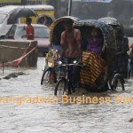 Rickshaws ply on deep-knee water in Dhaka city. Photo: BBN