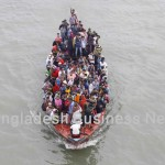Home-goers in a small boat in Bangladesh