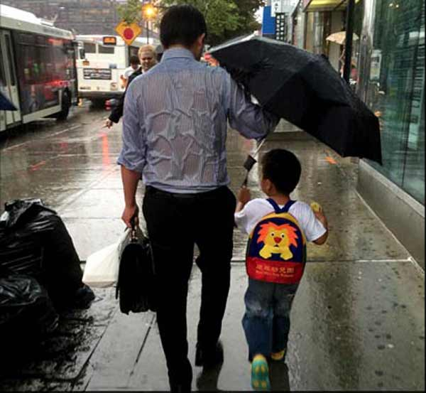 What's not to love about this dad braving the rain for his son?