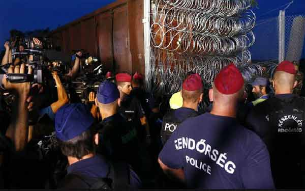 Hungary enacts tough migrant laws