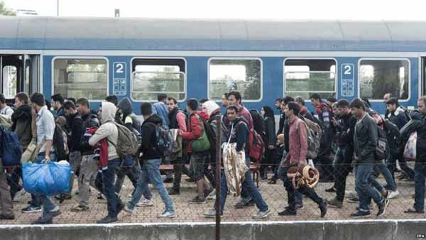 EU tries to resolve migrant quota rift