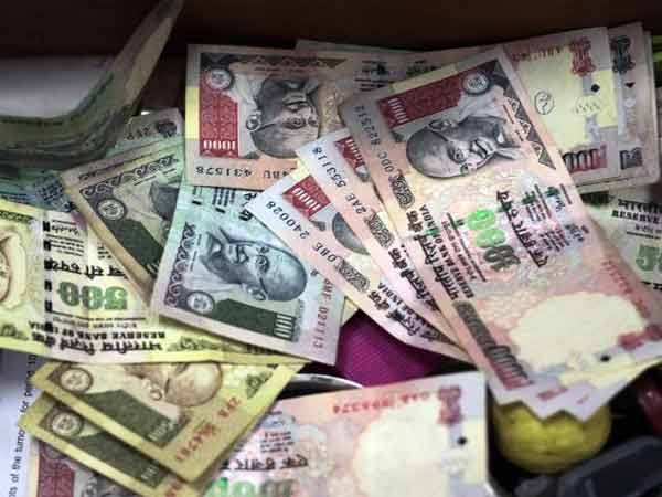 Indian Rupee up 9 paise against US dollar
