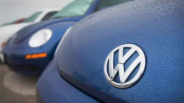 Volkswagen pushed into loss by emissions scandal