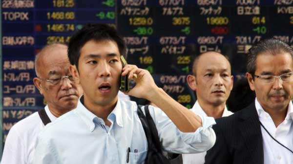 Volatile Chinese shares edge higher