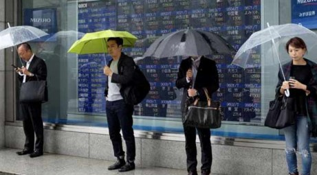 Asian shares fall in cautious trade