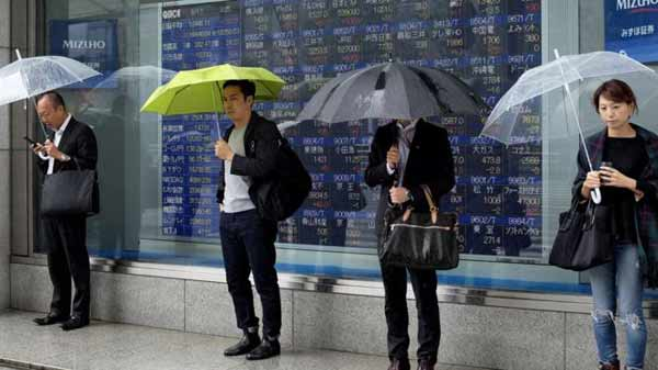 Asian shares in negative territory on China data