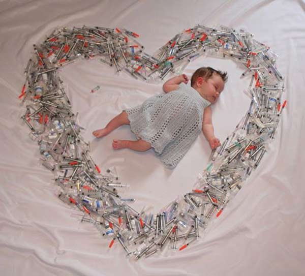 Sleeping baby surrounded by IVF syringes shows the full story of a mother's love