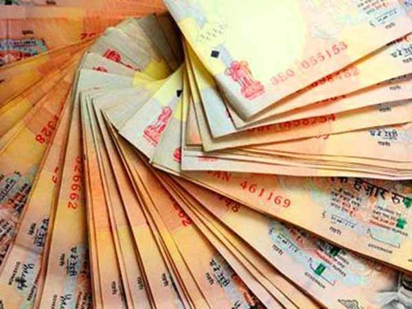 Rupee gains 12 paise to 66.67 against dollar