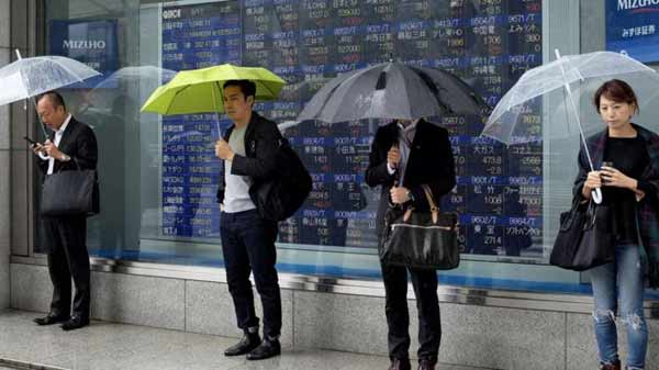 Asia shares hit by Fed and growth fears