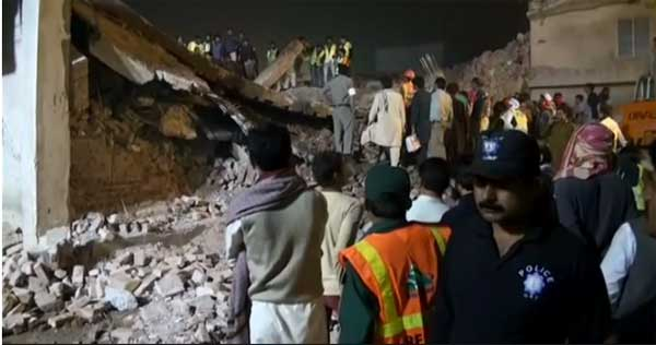 Voices heard in Pakistan collapse rubble, death toll 20