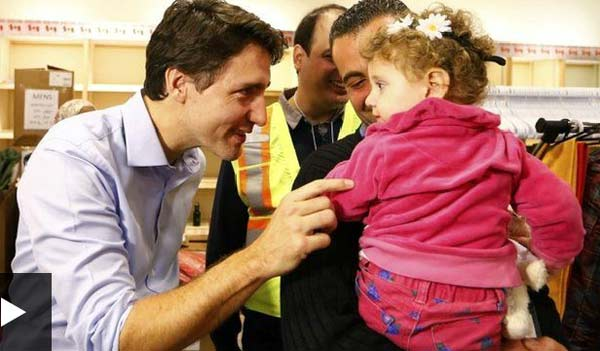 Canada PM welcomes 163 Syrian refugees