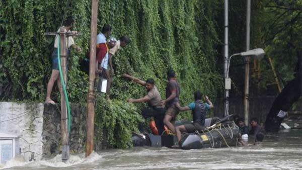 Race to rescue India flood victims