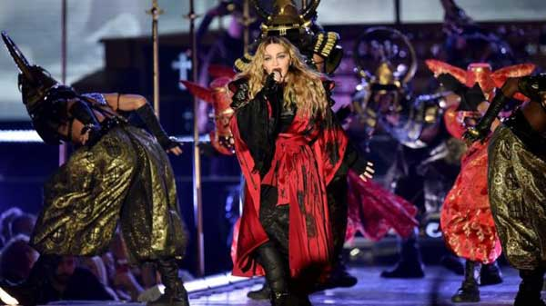 Madonna returns to scene of Brits fall