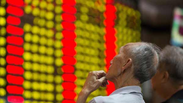 Chinese shares stop trading after 7% plunge