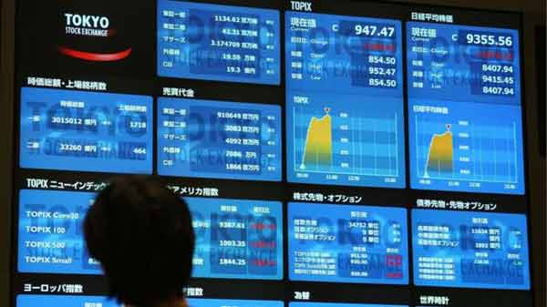 Asian shares mixed with traders wary