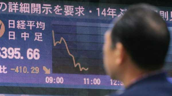 Japanese shares hit one-year low