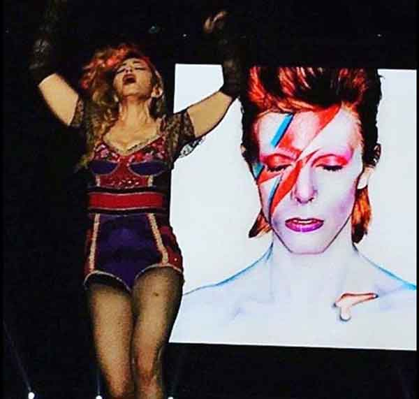Madonna collapses on stage as she pays tribute to late icon David Bowie