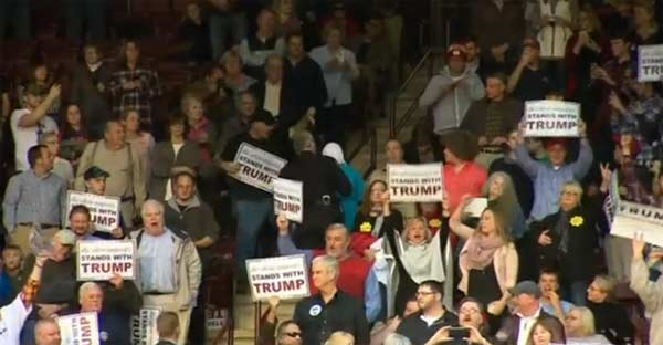 Trump urged to apologise to Muslim protester ejected from rally