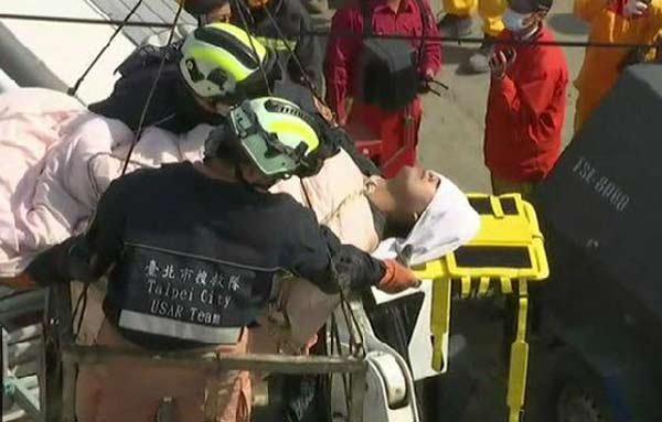 Woman rescued as Taiwan quake death toll reaches 35