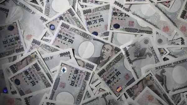 Tokyo starts lower on strong yen