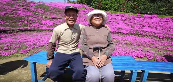 Man spent a decade building a garden so his blind wife could smell the flowers