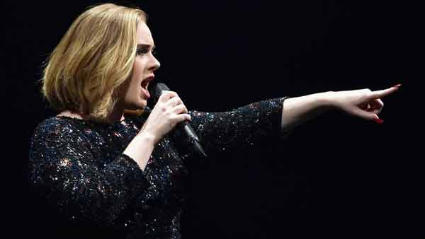 Adele fans pay tribute to victims of Brussels attacks at London concert
