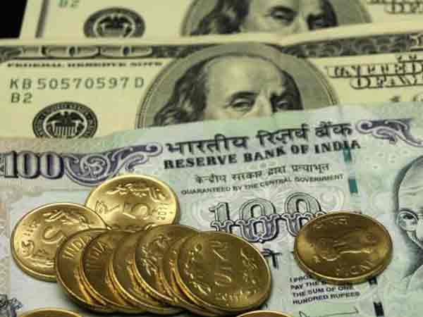 Indian rupee up by 12 paisa at Rs 67.19 vs US dollar