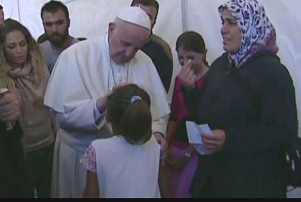 Pope visits Greek migrant camp