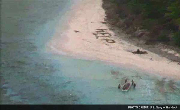 <strong>3 rescued from remote island after writing 'help' on the sand</strong>
