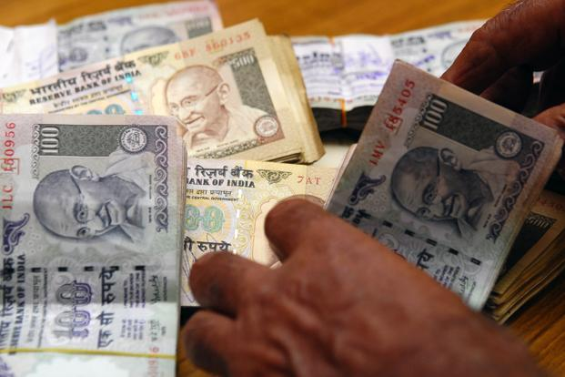 Rupee slips to 68.26 on dollar demand