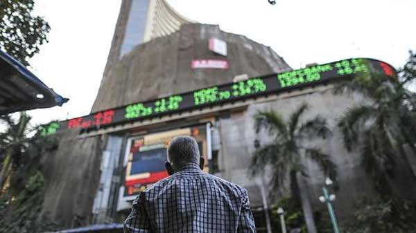 Asian shares trade lower
