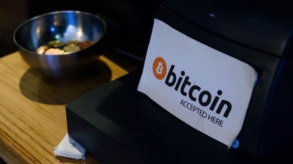 Bitcoin hits three-year high of $1000