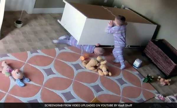 2-year-old boy rescues twin from under fallen dresser