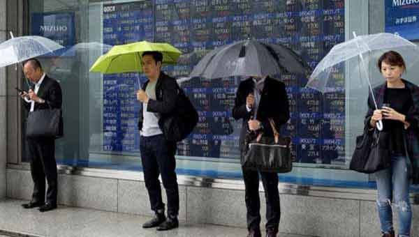Asian equities slip, dollar strengthens above 100 handle