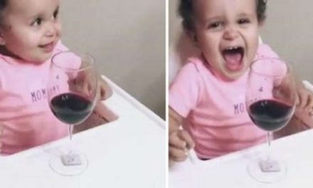 Only wine can make this baby smile!