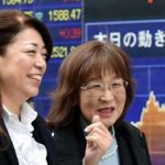 Asian shares nudge higher following US gains