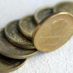 Indian Rupee pares early losses; still down by 18 paisa at 65.48