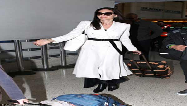 Jolie looks glamorous at LAX with her six children